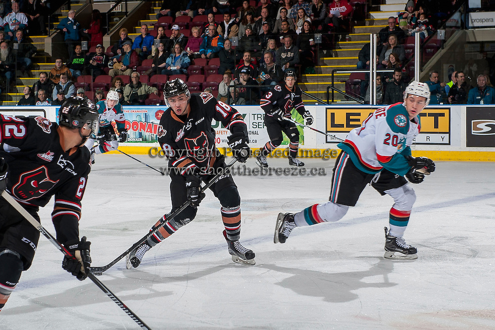 KELOWNA, CANADA - FEBRUARY 1: Murphy Stratton #18 of the Calgary Hitmen passes the puck ahead of Conner Bruggen-Cate #20 of the Kelowna Rockets on February 1, 2017 at Prospera Place in Kelowna, British Columbia, Canada.  (Photo by Marissa Baecker/Shoot the Breeze)  *** Local Caption ***