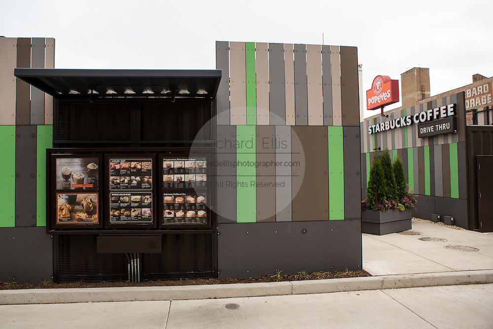 Starbucks Coffee shop built out of recycled shipping containers in Chicago, USA. Located at the corner of Broadway and Devon the drive-thru only store is part of Starbucks' strategy to develop store concepts from re-purposed materials.
