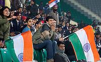 NEW DELHI -  Het Indiase publiek juicht bij een doelpunt van hun land tijdens de kwartfinale van  de finale ronde van de Hockey World League tussen de mannen van India en Australie. ANP KOEN SUYK