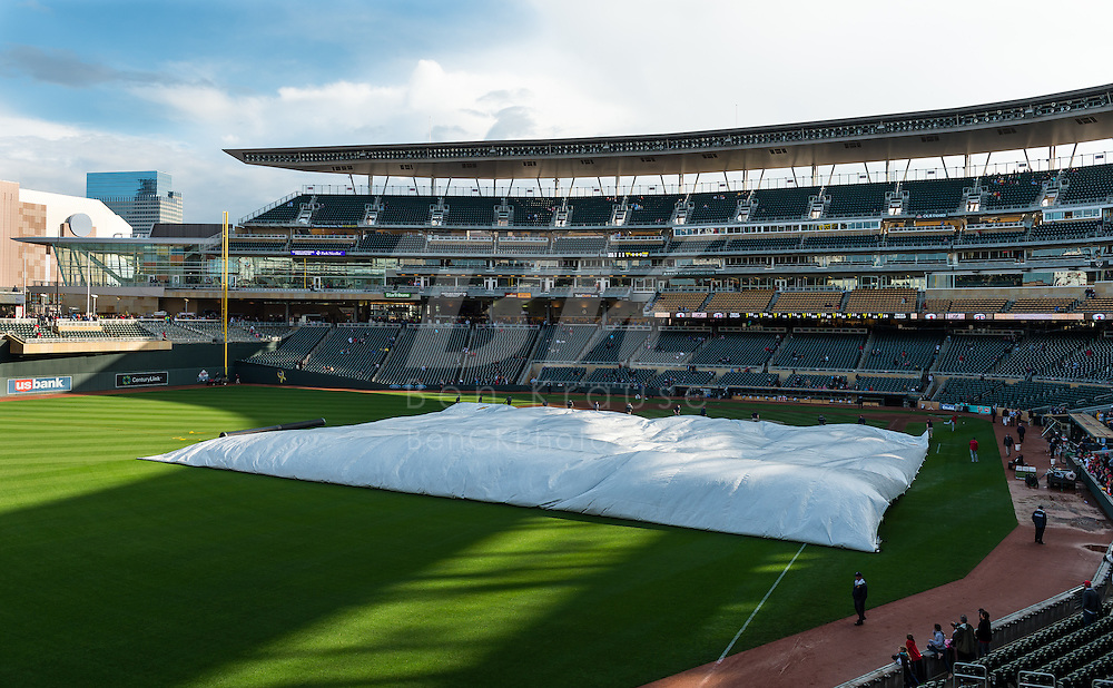 The grounds crew works to remove the tarp from the field prior to a game between the Minnesota Twins and Los Angeles Angels on May 8, 2012 at Target Field in Minneapolis, Minnesota.  The Twins defeated the Angels 5 to 0. © 2012 Ben Krause
