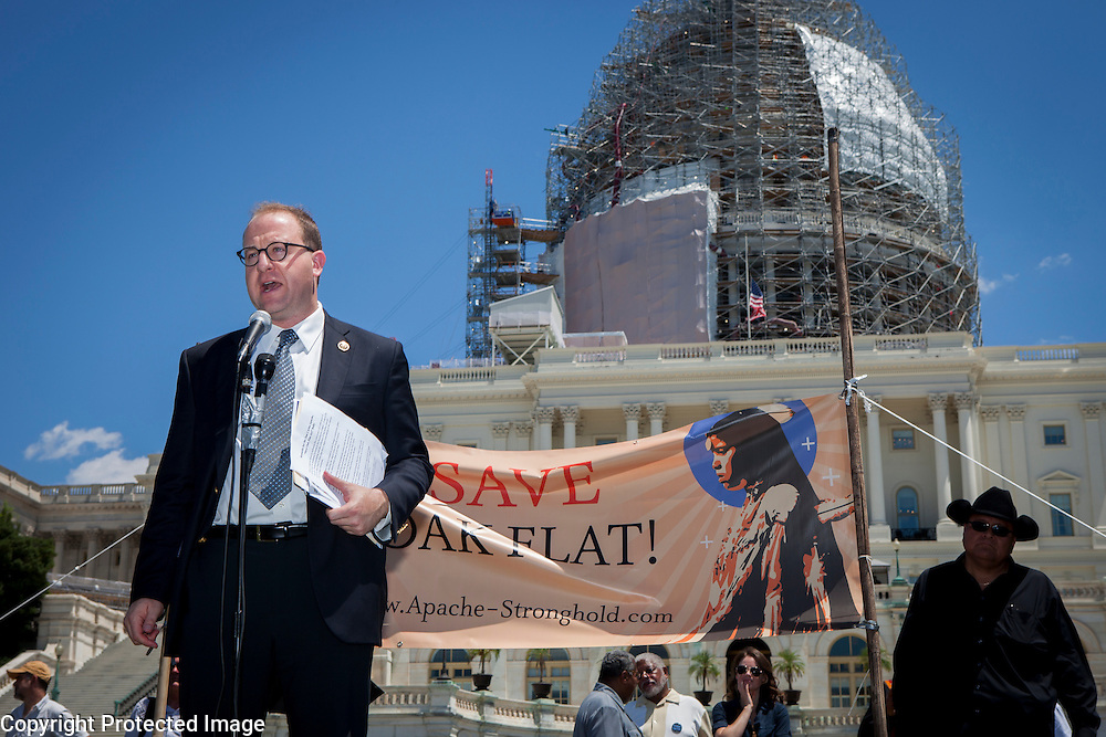 "Representative Jared Polis (D-CO-2) speaks to members of the San Carlos Apache Tribe and their supporters in front of the United States Capitol to protest the transfer of Apache land to a private Australian-British mining corporation.  In December 2014, a rider to the National Defense Authorization Act handed over Oak Flat to a foreign-owned company looking to mine copper.  The Apache are currently ""occupying"" Oak Flat, and travelled to D.C. to protest the action.  In response, Rep. Raul Grijalva (D-AZ-3), proposed the Save Oak Flat Act (H.R. 2811) in June, 2015 to repeal the land exchange.  Rep. Polis is a co-sponsor of that bill.  John Boal Photography"