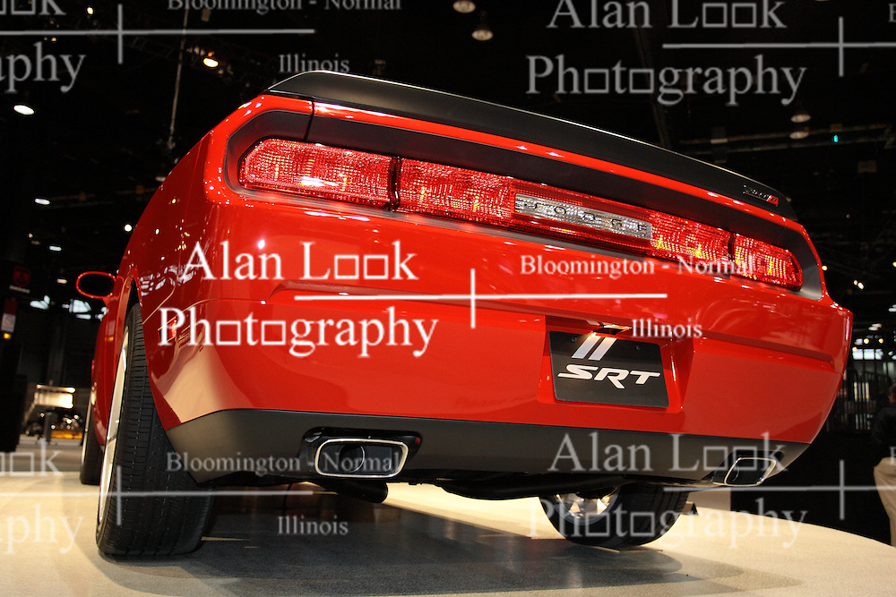 11 February 2009: 2009 Dodge Challenger. A 6.1-liter HEMI V-8 that produces 425 horses and 420 lb.-ft. of torque to the rear wheels powers the production version of the '08 Dodge Challenger SRT8. A 5-speed automatic gearbox is standard, and comes with a lock up torque converter and AutoStick. All four wheels are equipped with red, painted Brembo calipers, and offer customers benchmark braking.. The Chicago Auto Show is a charity event of the Chicago Automobile Trade Association (CATA) and is held annually at McCormick Place in Chicago Illinois