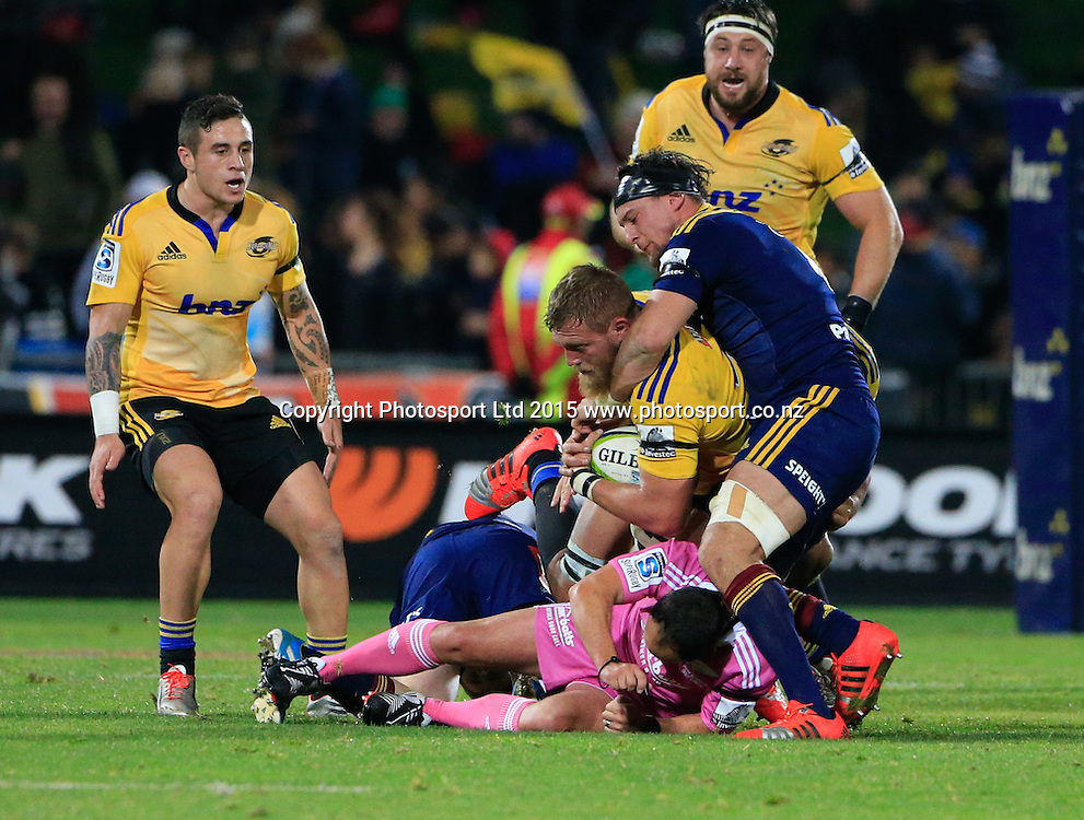 Referee Jaco Peyper is knocked to the ground. Super 15 rugby match. Hurricanes v Highlanders, McLean Park, Napier, New Zealand. Friday, 06 June, 2015. Photo: John Cowpland / www.photosport.co.nz