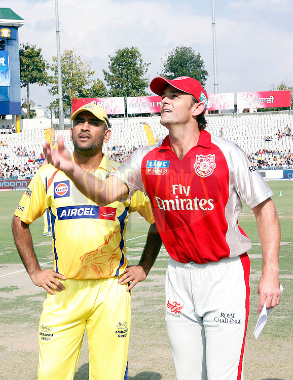 Kings XI Punjab captain Gill Christ (R) with Chennai Super Kings captain Mahender Singh Dhoni during the toss of during match 9 of the Indian Premier League ( IPL ) Season 4 between the Kings XI Punjab and the Chennai Super Kings held at the PCA stadium in Mohali, Chandigarh, India on the 13th April 2011..Photo by Money Sharma/BCCI/SPORTZPICS