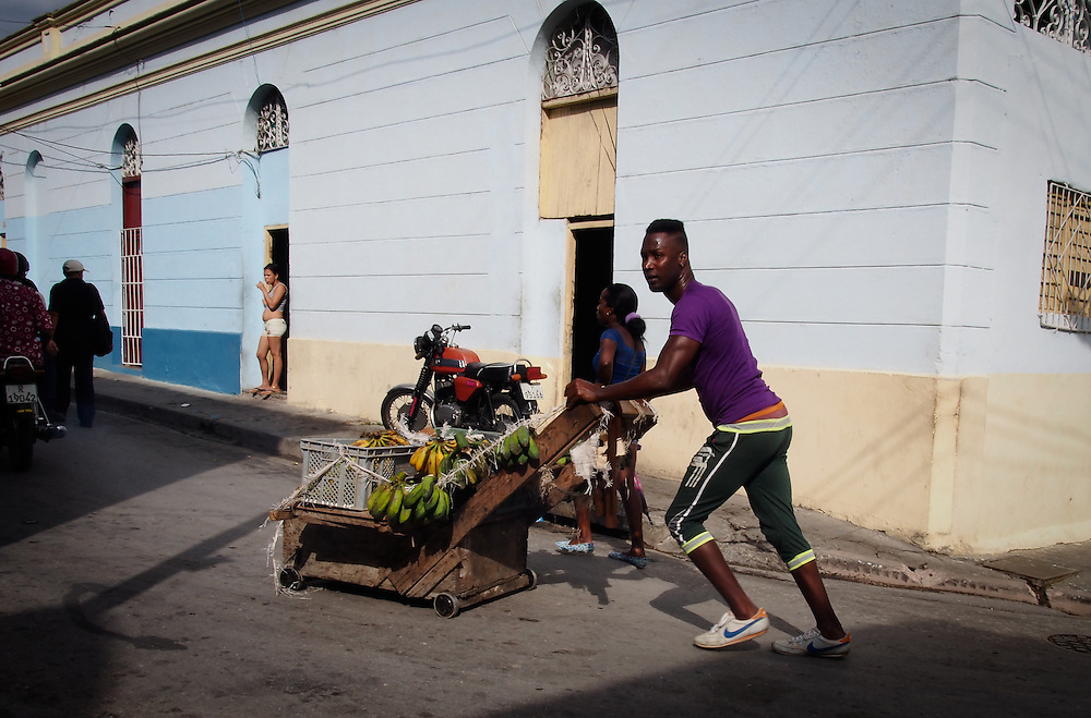 A vendor pushes a traditional cart selling his wares on the streets of Santiago de Cuba
