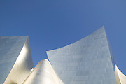 Sharp angles and smooth curves of Walt Disney Concert Hall with blue sky above, 135 North Grand Ave, Los Angeles, CA 90012, Part of Music Center, Performing Arts Center of Los Angeles County, California...Subject photograph(s) are copyright Edward McCain. All rights are reserved except those specifically granted by Edward McCain in writing prior to publication...McCain Photography.211 S 4th Avenue.Tucson, AZ 85701-2103.(520) 623-1998.mobile: (520) 990-0999.fax: (520) 623-1190.http://www.mccainphoto.com.edward@mccainphoto.com.