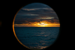 SOUTHERN PACIFIC ESPERANZA 5DEC07 - Sunset seen through a porthole aboard the MY Esperanza in the southern Pacific...jre/Photo by Jiri Rezac..© Jiri Rezac 2007..Contact: +44 (0) 7050 110 417.Mobile:  +44 (0) 7801 337 683.Office:  +44 (0) 20 8968 9635..Email:   jiri@jirirezac.com.Web:    www.jirirezac.com..© All images Jiri Rezac 2007 - All rights reserved.