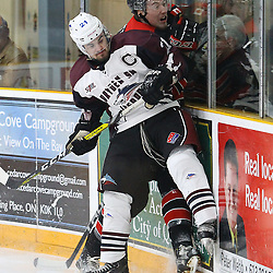 "TRENTON, ON  - MAY 2,  2017: Canadian Junior Hockey League, Central Canadian Jr. ""A"" Championship. The Dudley Hewitt Cup. Game 1 between Dryden GM Ice Dogs and the Georgetown Raiders.  Derek McPhail #21 of the Dryden GM Ice Dogs hits a Georgetown Raiders player during the first period<br /> (Photo by Alex D'Addese / OJHL Images)"
