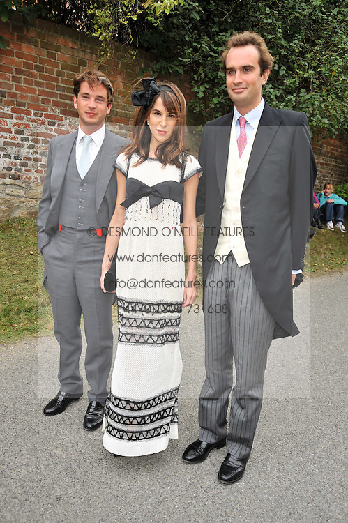 Left to right, the HON.JAMES TOLLEMACHE, CAROLINE SIEBER and FRITZ VON WESTENHOLZ at the wedding of Lohralee Stutz and the Hon.William Astor at St.Augustine's Church, East Hendred, Oxfordshire on 5th September 2009.