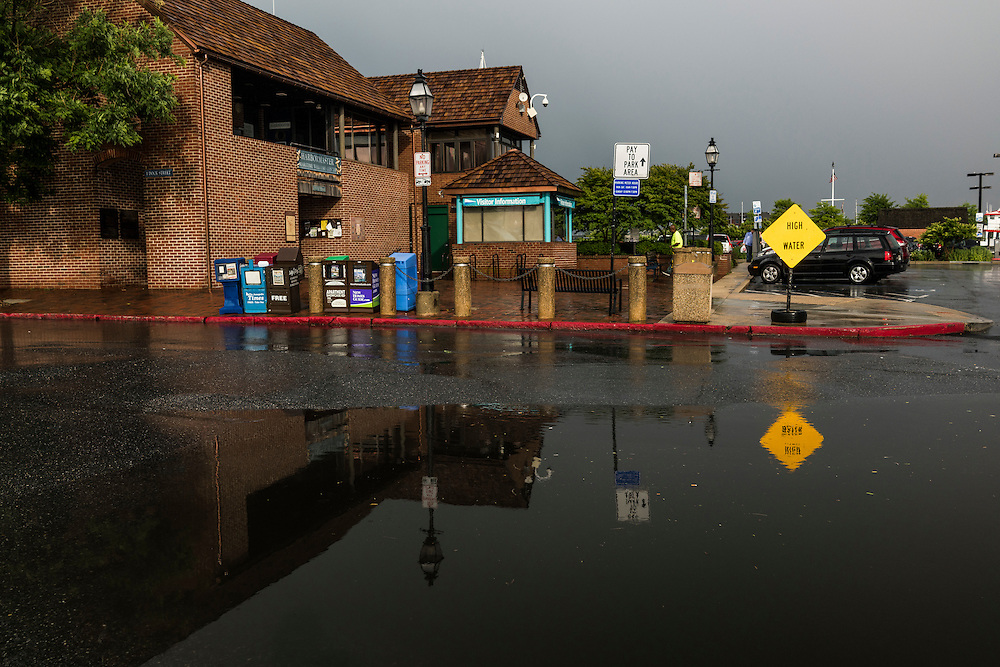 Annapolis, Maryland - June 05, 2016: A huge puddle sits in front of the Harbor Master's office on Dock Street in Historic Annapolis Sunday Morning June 5th, 2016. The puddle is an example of nuisance flooding and was exacerbated by the morning's perigean spring tide.<br /> <br /> <br /> A perigean spring tide brings nuisance flooding to Annapolis, Md. These phenomena -- colloquially know as a &quot;King Tides&quot; -- happen three to four times a year and create the highest tides for coastal areas, except when storms aren't a factor. Annapolis is extremely susceptible to nuisance flooding anyway, but the amount of nuisance flooding has skyrocketed in the last ten years. Scientists point to climate change for this uptick. <br /> <br /> <br /> CREDIT: Matt Roth for The New York Times<br /> Assignment ID: 30191272A