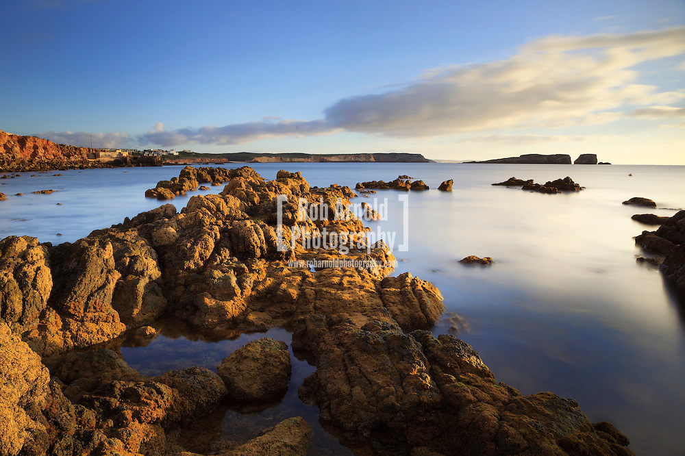 19/11/2013. Sagres, Portugal. A morning view of rocks on a beach in Sagres, Portugal shortly after sunrise. Photo Credit : Rob Arnold