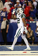 New York Jets running back Matt Forte (22) points skyward in celebration after running for a 12 yard touchdown good for a 37-24 fourth quarter lead during the 2016 NFL week 2 regular season football game against the against the Buffalo Bills on Thursday, Sept. 15, 2016 in Orchard Park, N.Y. The Jets won the game 37-31. (©Paul Anthony Spinelli)