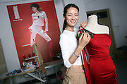 Chinese designer and former fashion model Mary Ma works on a dress in her Beijing fitting room.