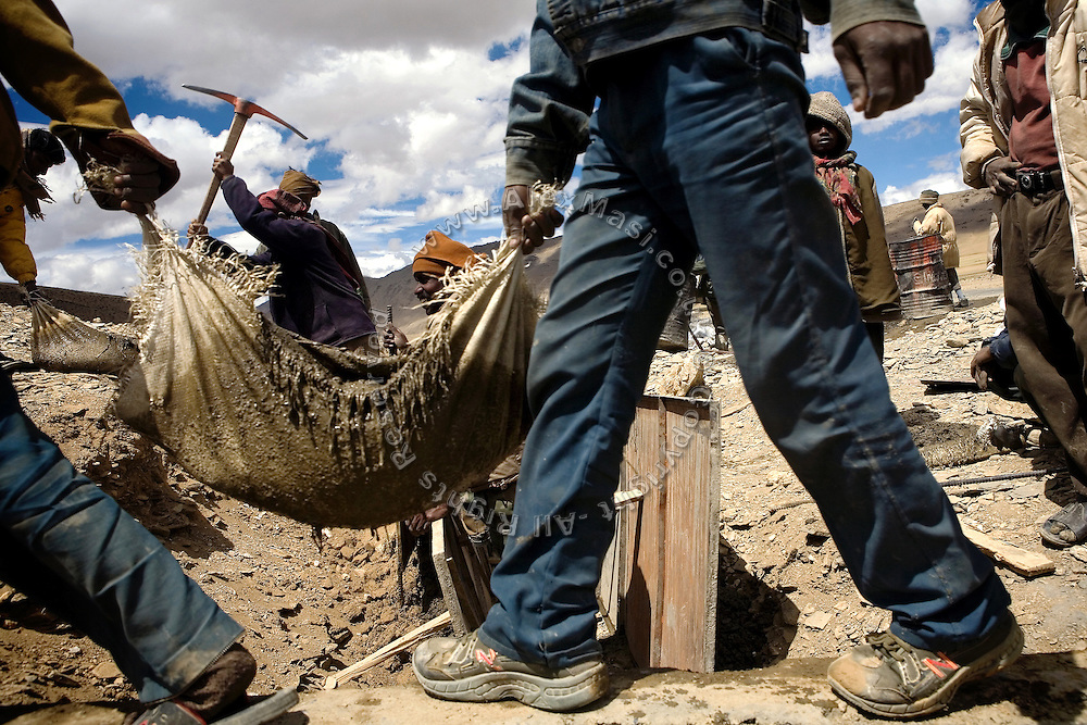 Labourers are busy on fixing the road on the Leh-Manali Highway.