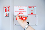 Israel, Interior of a train coach Passenger pulls the emergency brake