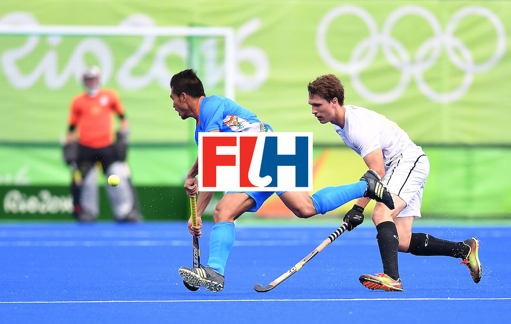 India's Chinglensana Kangujam and Canada's Taylor Curran (R) vie during the mens's field hockey India vs Canada match of the Rio 2016 Olympics Games at the Olympic Hockey Centre in Rio de Janeiro on August, 12 2016. / AFP / MANAN VATSYAYANA        (Photo credit should read MANAN VATSYAYANA/AFP/Getty Images)