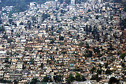 Port-au-Prince, Haiti.<br /> Shanty houses and slum dwellings are built all over the city, from the coast up to the mountains. Building on the steep slopes causes erosion.