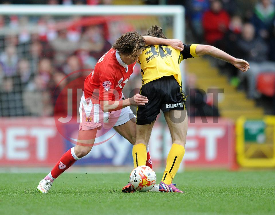 Bristol City's Luke Freeman challenges Barnsley's Ben Pearson - Photo mandatory by-line: Dougie Allward/JMP - Mobile: 07966 386802 - 28/03/2015 - SPORT - Football - Bristol - Ashton Gate - Bristol City v Barnsley - Sky Bet League One