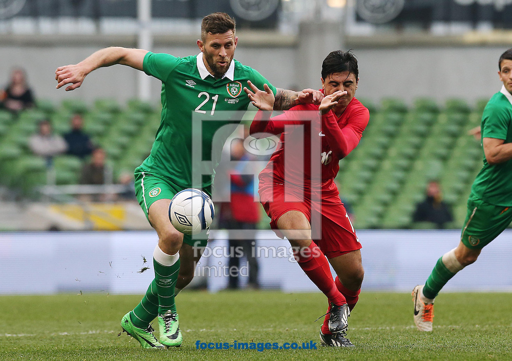 Daryl Murphy of the Republic of Ireland tackles Nuri Sahin of Turkey during the International Friendly match at the Aviva Stadium, Dublin<br /> Picture by Lorraine O'Sullivan/Focus Images Ltd +353 872341584<br /> 25/05/2014