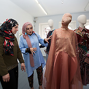 """18.05.2018.          <br /> More than 500 people attended the flagship event of the inaugural Unwrap LSAD Fashion Festival in Limerick.<br /> <br /> Graduate Aysha Birani, Ontario Cnanade is pictured with her mother Hanan Birani with Aysha's Design, Cacophony.<br /> <br /> The Limerick School of Art & Design, LIT, Fashion Design Graduate Exhibition and launch of the """"The Fashion Film"""" at Limerick City Gallery of Art, in partnership with EVA International, attracted hundreds of people from the world of fashion. <br /> <br /> A total of 27 fashion graduates presented their designs alongside the specially commissioned film by fashion stylist and creative director Kieran Kilgallon and videographer Albert Hooi. Picture: Alan Place"""