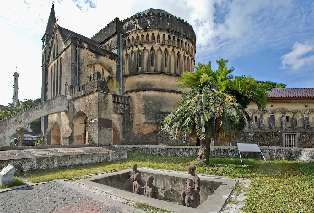 View of Christ Church and its adjoining slave memorial, in Stone Town, Tanzania, East Africa.  Built 1873-1883 of coral stone, designed by Edward Steere, then Anglican bishop.  Style is Gothic revival.