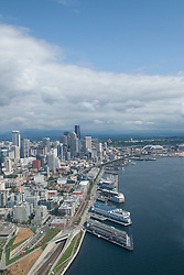 North America, United States, Washington, Seattle aerial view of downtown skycrapers, Olympic Sculpture Park, stadiums and Port of Seattle