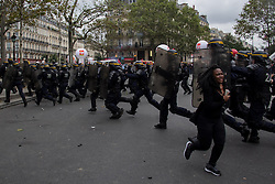 September 15, 2016 - Paris, France - A woman runs from police during demonstrations. Parisians took to the streets Thursday to demonstrate over the controversial Labor Law reform in France. Thousands gathered at Place de la Bastille for a peaceful walk to Place de la Republique, but an anarchist group clashed in a confrontation with police. (Credit Image: © David Cordova/NurPhoto via ZUMA Press)