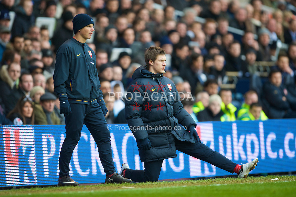 LONDON, ENGLAND - Sunday, February 8, 2009: Arsenal's unused substitutes Aaron Ramsey and Andrey Arshavin during the Premiership match against Tottenham Hotspur at White Hart Lane. (Mandatory credit: David Rawcliffe/Propaganda)