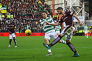 Hearts FC Defender Igor Rossi Branco makes a vital clearance from Celtic FC Midfielder Tom Rogics attack during the Ladbrokes Scottish Premiership match between Heart of Midlothian and Celtic at Tynecastle Stadium, Gorgie, Scotland on 27 December 2015. Photo by Craig McAllister.