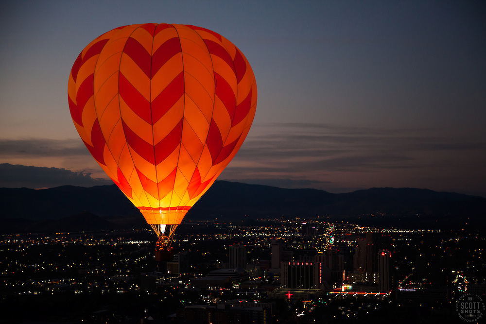 """""""Dawn Patrol 15"""" - Photograph of a glowing hot air balloon flying for the Dawn Patrol at the 2012 Great Reno Balloon Race. Photographed from a hot air balloon."""