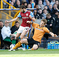 Photo: Steve Bond/Richard Lane Photography. Wolverhampton Wanderers v Aston Villa. Barclays Premiership 2009/10. 24/10/2009. Carlos Cuellar (L) is fouled on the touchline by Kevin Doyle