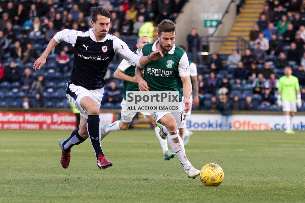 Raith Rovers's Grant Anderson chases down the ball alongside Hibernian's Lewis Stevenson in the Raith Rovers vs Hibernian Scottish Championship 24th October 2015......(c) MARK INGRAM | SportPix.org.uk