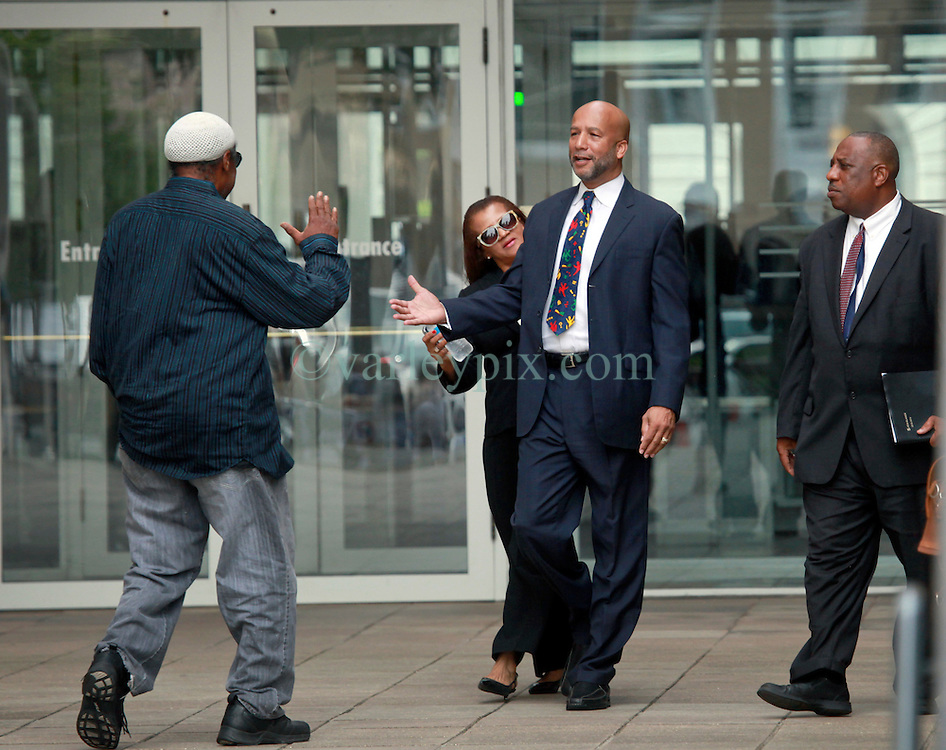 09 July 2014. New Orleans, Louisiana. <br /> Ray Nagin, former mayor of New Orleans leaves Federal Court in New Orleans with wife Seletha Smith following his sentencing hearing. He is greeted by friend Jerome Smith (l). Attorney Robert Jenkins (l).  Nagin was sentenced to serve 10 years in prison for bribery and money laundering. <br /> Photo; Charlie Varley/varleypix.com