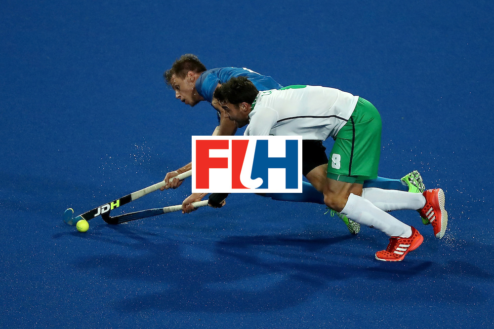 RIO DE JANEIRO, BRAZIL - AUGUST 12:  Chris Cargo #8 of Ireland and Lucas Rossi #27 of Argentina compete for a loose ball during a Men's Preliminary Pool A match on Day 7 of the Rio 2016 Olympic Games at the Olympic Hockey Centre on August 12, 2016 in Rio de Janeiro, Brazil.  (Photo by Sean M. Haffey/Getty Images)