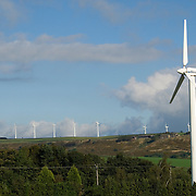 Electrical generating wind turbines in wind farms on the top of the English Pennine Hills in Britain.