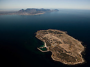 Robben Island with Cape Town in background. Aerial Images of Cape Town by Greg Beadle