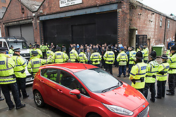 © Licensed to London News Pictures . 07/04/2018. Manchester, UK. Police contain and kettle fans running through streets and chanting Manchester City slogans in Manchester's Northern Quarter , ahead of the Manchester City vs Manchester United derby match. If they win the match, Manchester City will win the League title. Photo credit : Joel Goodman/LNP