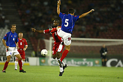 BELGRADE, SERBIA & MONTENEGRO - Wednesday, August 20, 2003: Wales' Nathan Blake and Serbia & Montenegro's Dejan Stefanovic during the UEFA European Championship qualifying match at the Red Star Stadium. (Pic by David Rawcliffe/Propaganda)