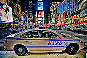 Wide angle picture of a police car parked in the middle of Times Square, Manhattan, New York, 2010.