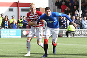 Rangers forward Kyle Lafferty (11) and Hamilton Accademical defender Ziggy Gordon (4) race towards the ball during the Ladbrokes Scottish Premiership match between Hamilton Academical FC and Rangers at New Douglas Park, Hamilton, Scotland on 24 February 2019.