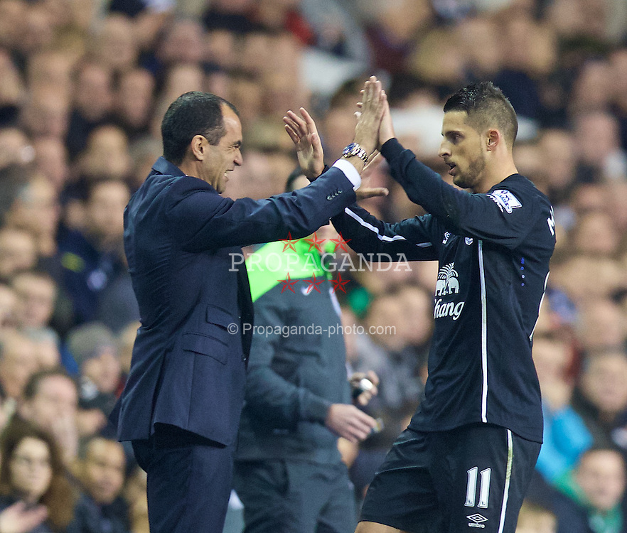 LONDON, ENGLAND - Sunday, November 30, 2014: Everton's Kevin Mirallas celebrates scoring the first goal against Tottenham Hotspur with manager Roberto Martinez during the Premier League match at White Hart Lane. (Pic by David Rawcliffe/Propaganda)
