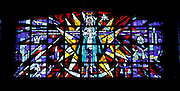 A stained glass window of Mary with the child Jesus appears in the choir loft at St. Mary Church. (Photo by Sam Lucero)