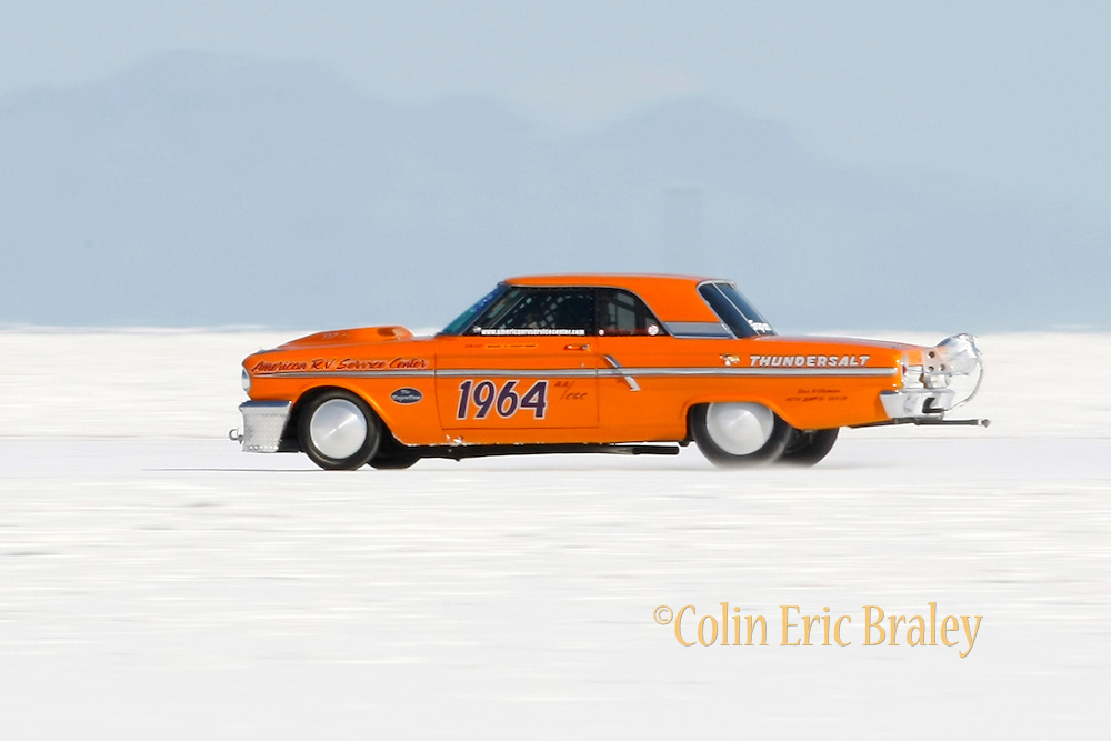 Best cars-people-atmosphere-photos of 2009 Bonneville Speed Week- A 1964 Ford Fairlane, owned a driven by Brain Dean of Orangeville CA. heads down the long course at the Bonneville Speed Way. August 9, 2009.  Photo by Colin E. Braley