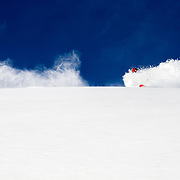 Hadley Hammer skis blue bird powder in the Tetons of Wyoming.