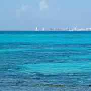 View of Cancun hotel zone from south shore. Isla Mujeres, Quintana Roo. Mexico.