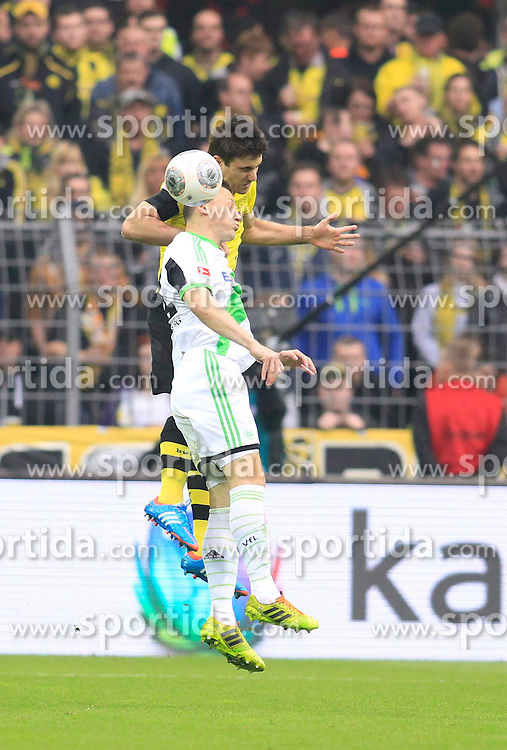 05.04.2014, Signal Iduna Park, Dortmund, GER, 1. FBL, Borussia Dortmund vs VfL Wolfsburg, 29. Runde, im Bild Sokratis (Borussia Dortmund #25) im Kopfballduell gegen Ivica Olic (VfL Wolfsburg #11) // during the German Bundesliga 29th round match between Borussia Dortmund and VfL Wolfsburg at the Signal Iduna Park in Dortmund, Germany on 2014/04/05. EXPA Pictures &copy; 2014, PhotoCredit: EXPA/ Eibner-Pressefoto/ Schueler<br /> <br /> *****ATTENTION - OUT of GER*****