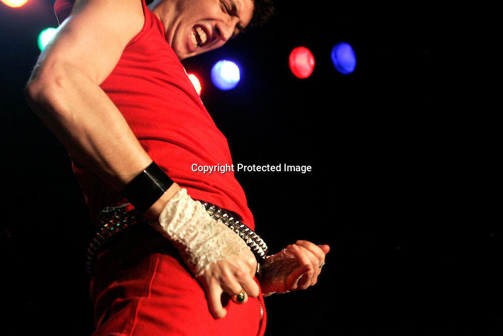 Jamie 'Chuck Norris' Stern performs during the regional finals of the US Air Guitar Champions in New York March 2, 2006. The winner of the contest goes on to the national championship for a chance to represent America in the world championship in Finland.