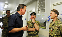 STRICT EMBARGO UNTIL 1800HRS 04 JULY 2011© Licensed to London News Pictures. 04/07/2011. British Prime Minister David Cameron visited members of the Role 3 military hospital today (4 Jul 11) in Camp Bastion, Afghanistan. The PM was shown around the state of the art facility and given an insight into the treatment of ISAF and Afghan casualties. See special instructions. Mandatory Photo credit : Sergeant Alison Baskerville/LNP