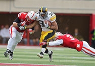 November 25, 2011: Iowa Hawkeyes running back Marcus Coker (34) is hit by Nebraska Cornhuskers linebacker Will Compton (51) and Nebraska Cornhuskers safety Daimion Stafford (3) during the first half of the NCAA football game between the Iowa Hawkeyes and the Nebraska Cornhuskers at Memorial Stadium in Lincoln, Nebraska on Friday, November 25, 2011.