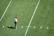 PALO ALTO, CA - NOV 1991:  Dennis Green, Stanford University Head Coach, watches warmups on the field before a Stanford Cardinal football game played in September 1991 at Stanford Stadium in Palo Alto, California. (Photo by David Madison/Getty Images)